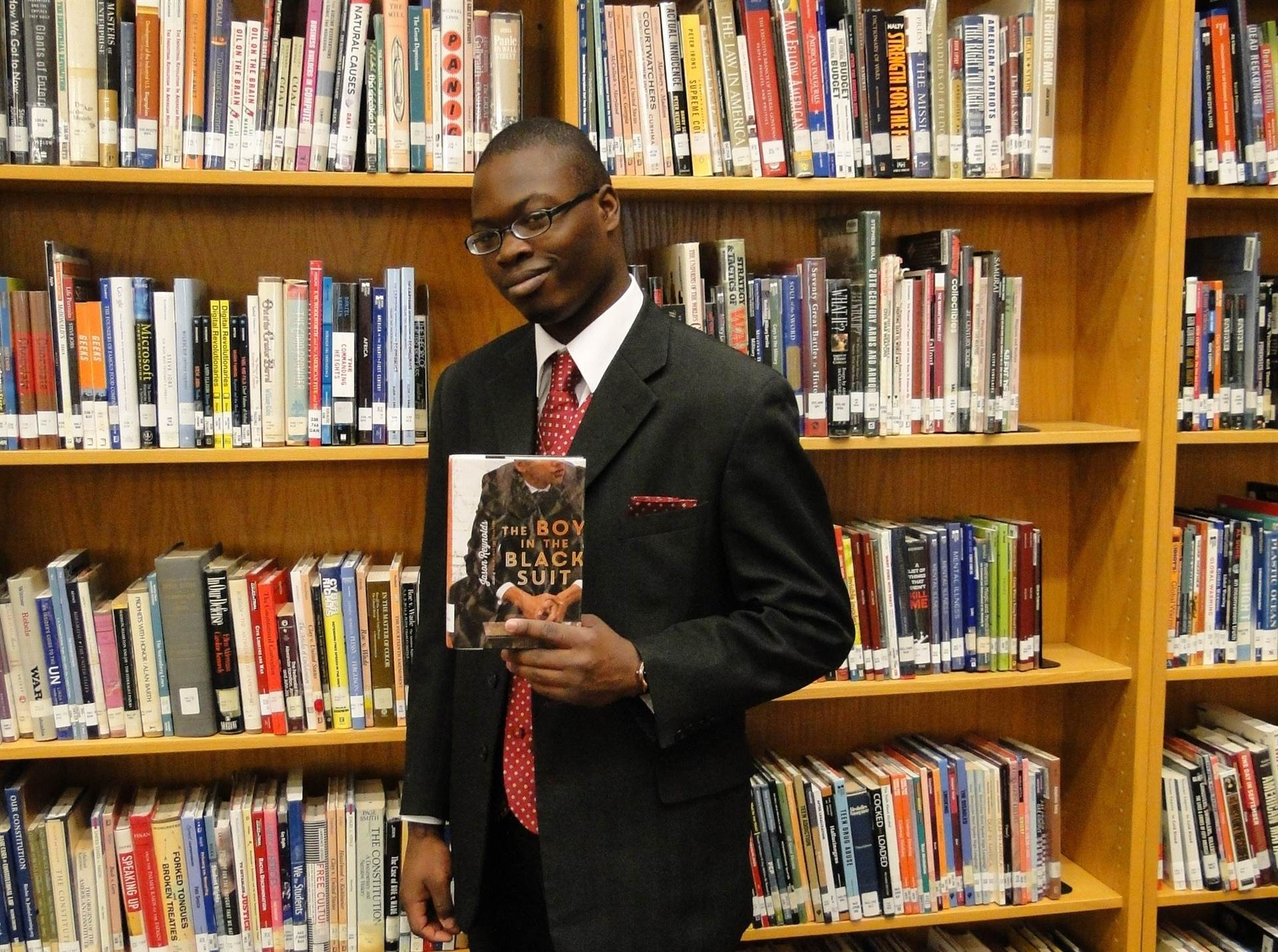 Darwin Scott with the book 'The Boy in the Black Suit.'