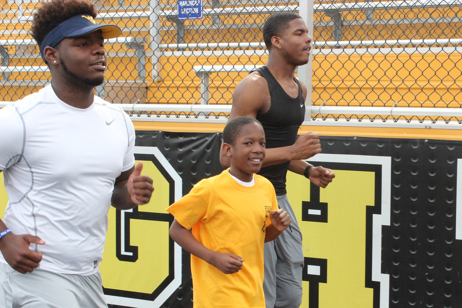 Boulevard student and Special Olympian Jayson Mosley training with Heights High juniors Kenneth Roye' Jr. (left) and Jaylen Harris.