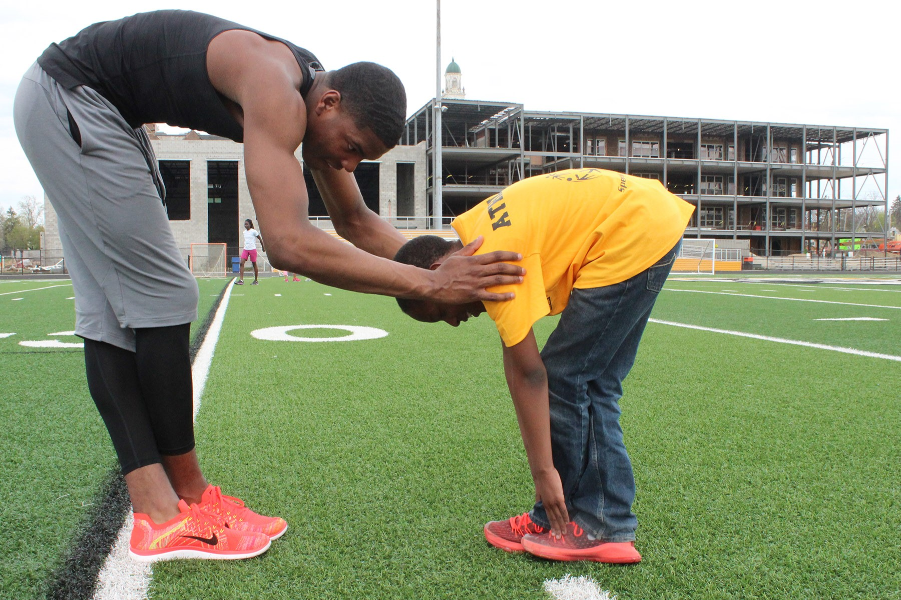 Boulevard student and Special Olympian Jayson Mosley stretching with Heights High junior Jaylen Harris.