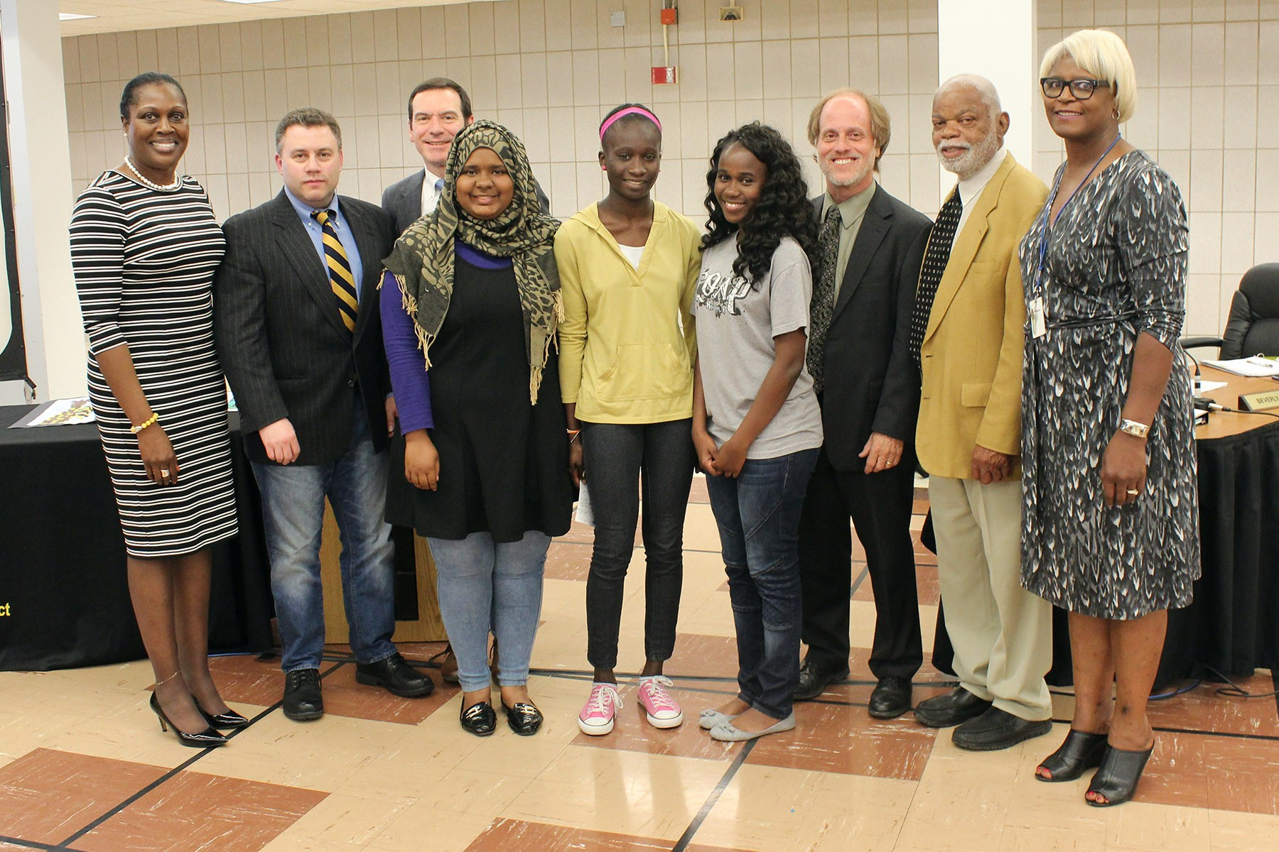 Three foreign exchange students from the high school's AFS program spoke at the meeting.