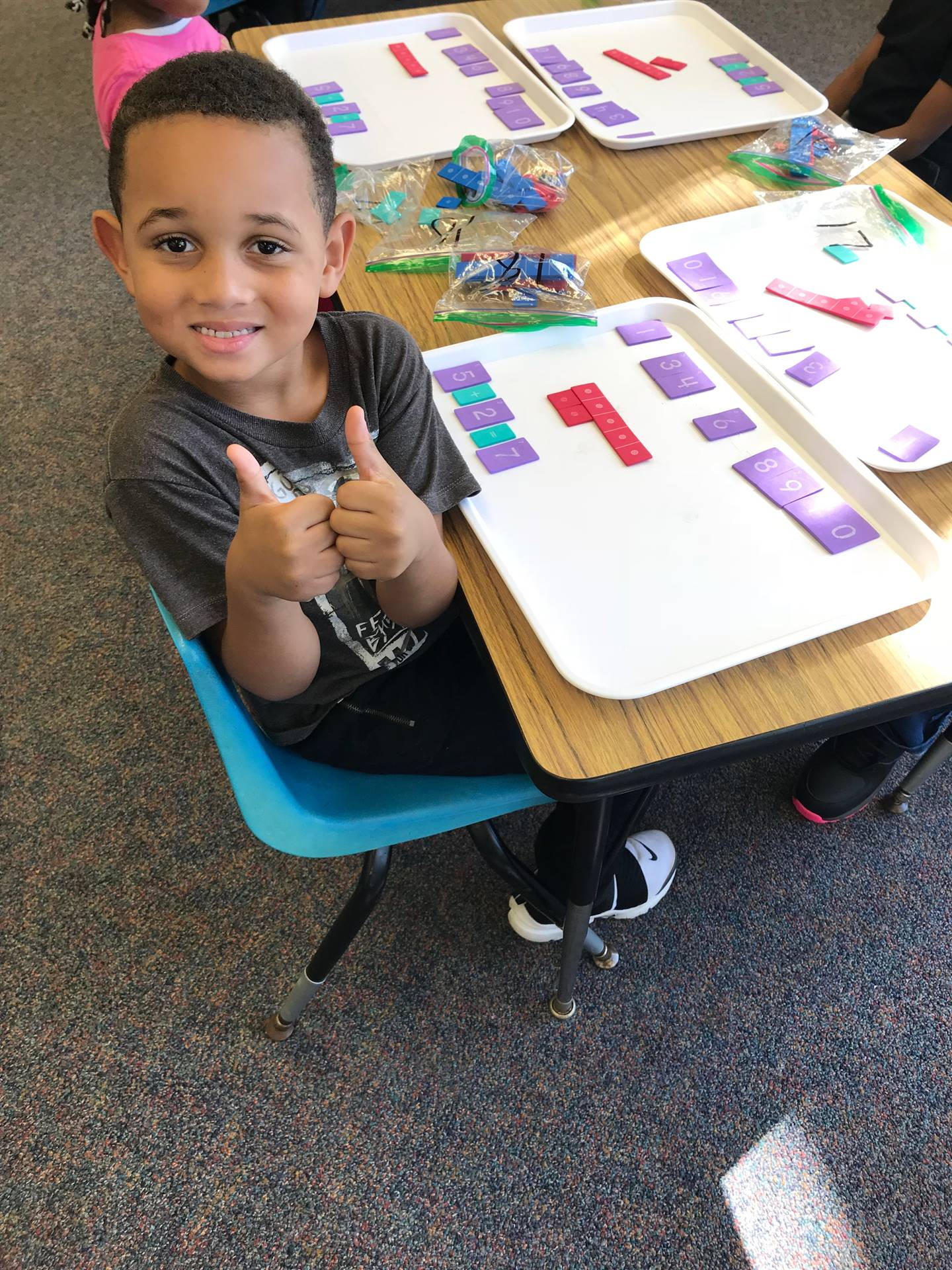 Kindergartners learn how to build equations and read number sentences.