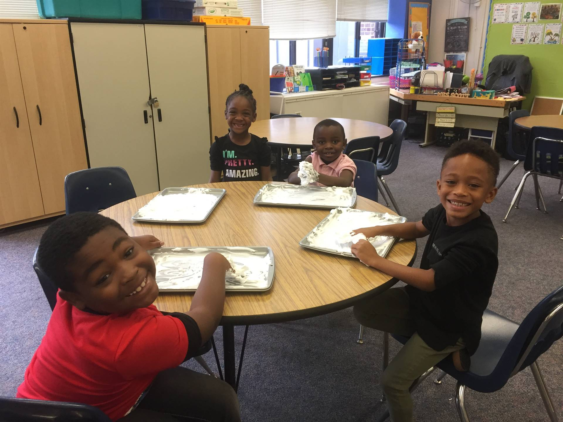 1st grade students practice their letters in shaving cream!
