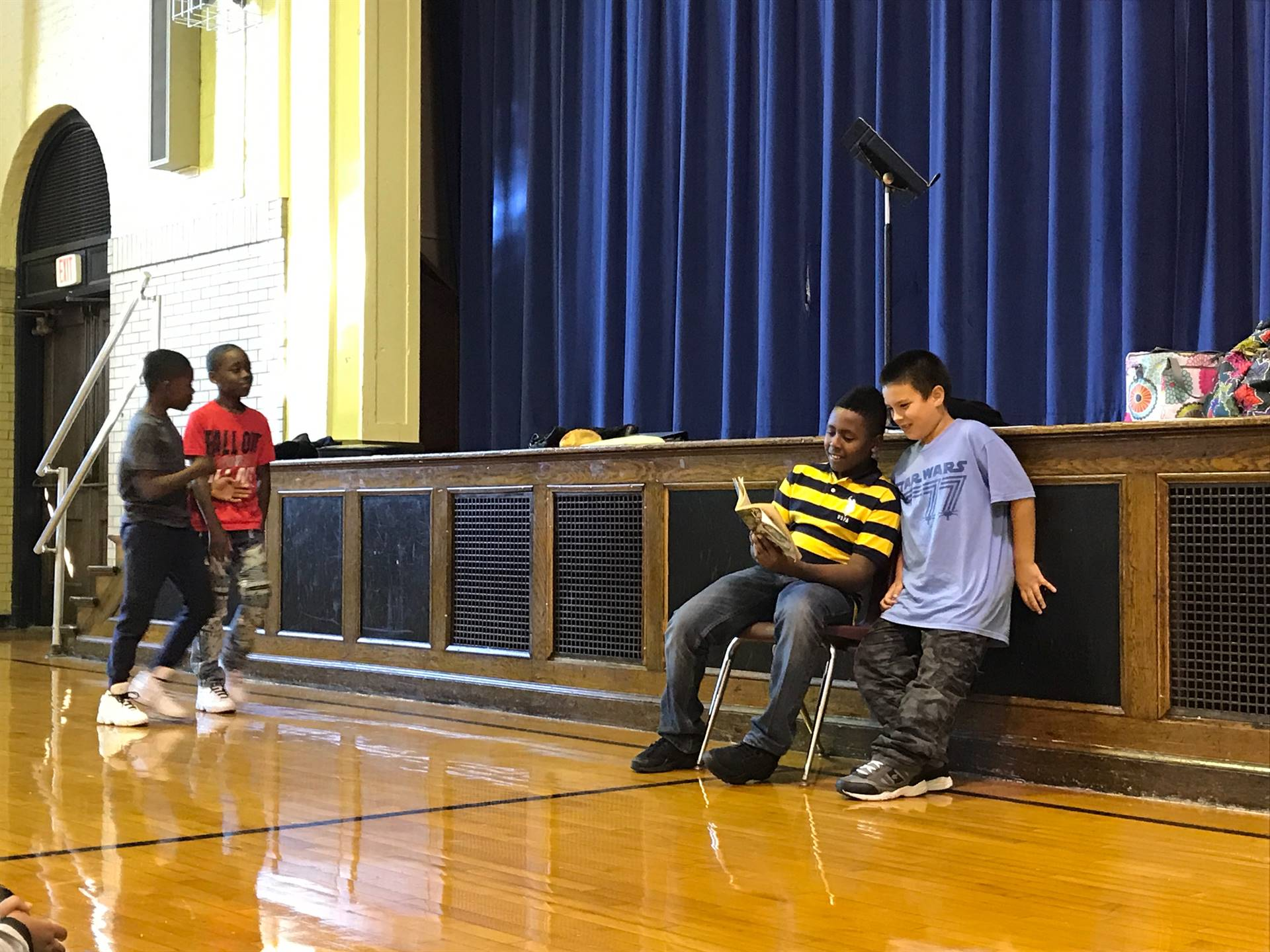 Students perform skits for one another demonstrating the Disney Promises!