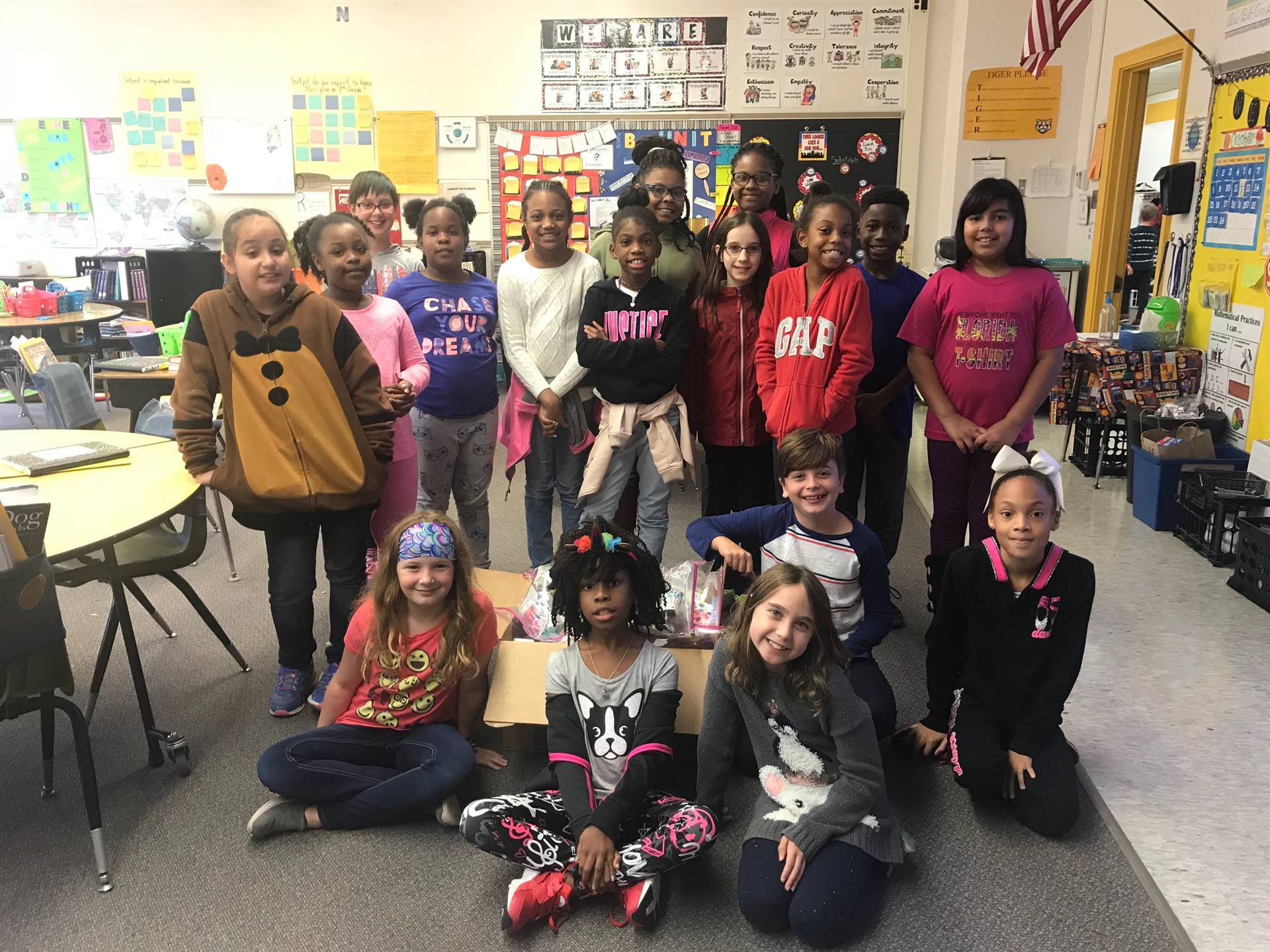 4th graders pack the bags and load the boxes for victims of the wild fires in CA.