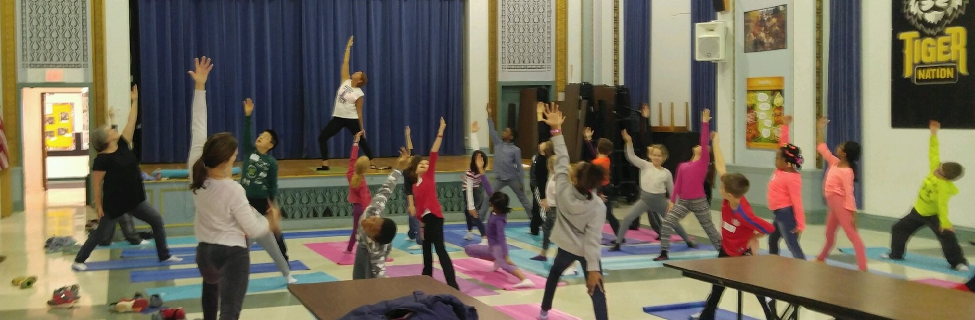 3rd Graders practice yoga as part of I-Pride