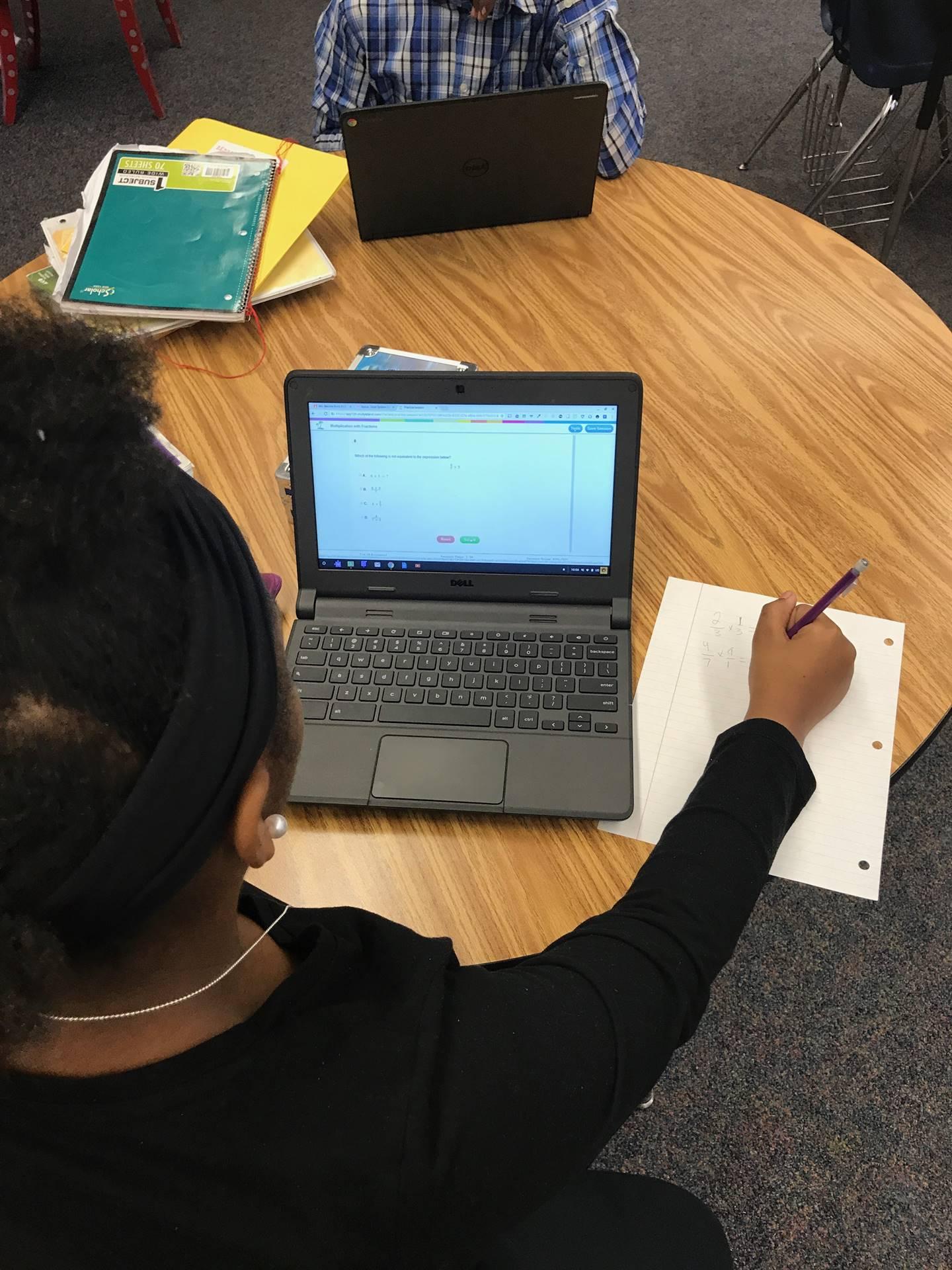Students using AVID notetaking skills in 3rd grade