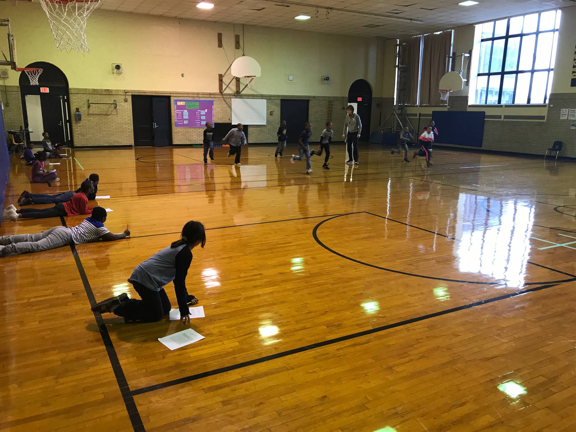 3rd graders practicing pacing their running with partners