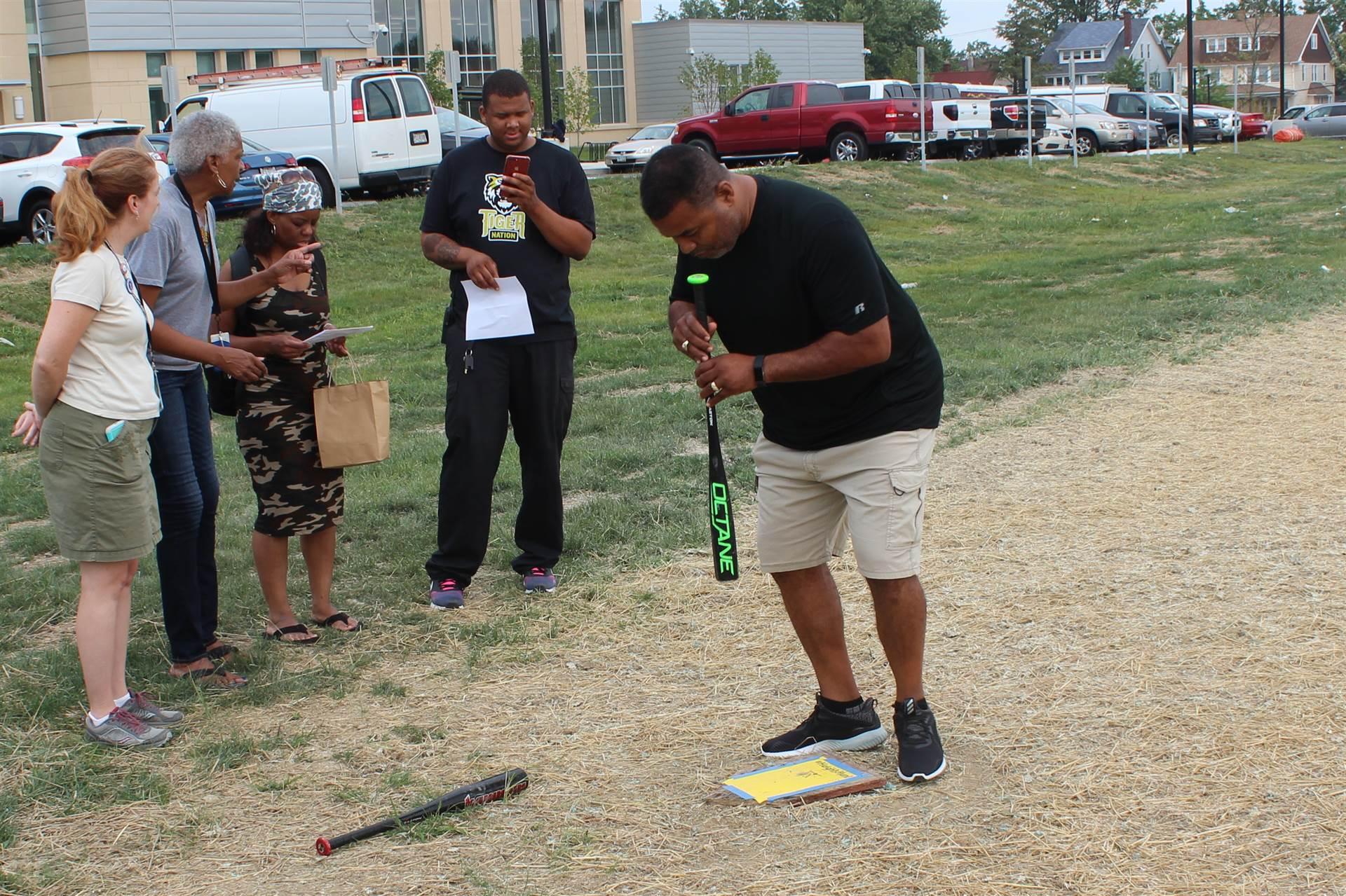 PE teacher Mike Jones expertly executes activity at baseball field.