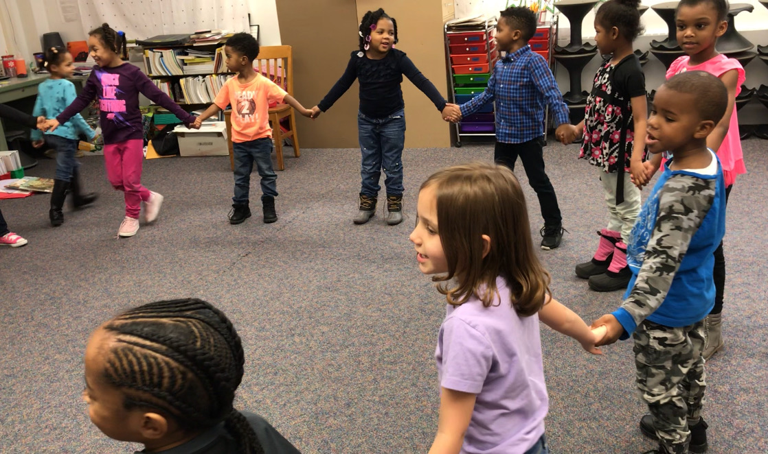 Kindergarten students work together in music