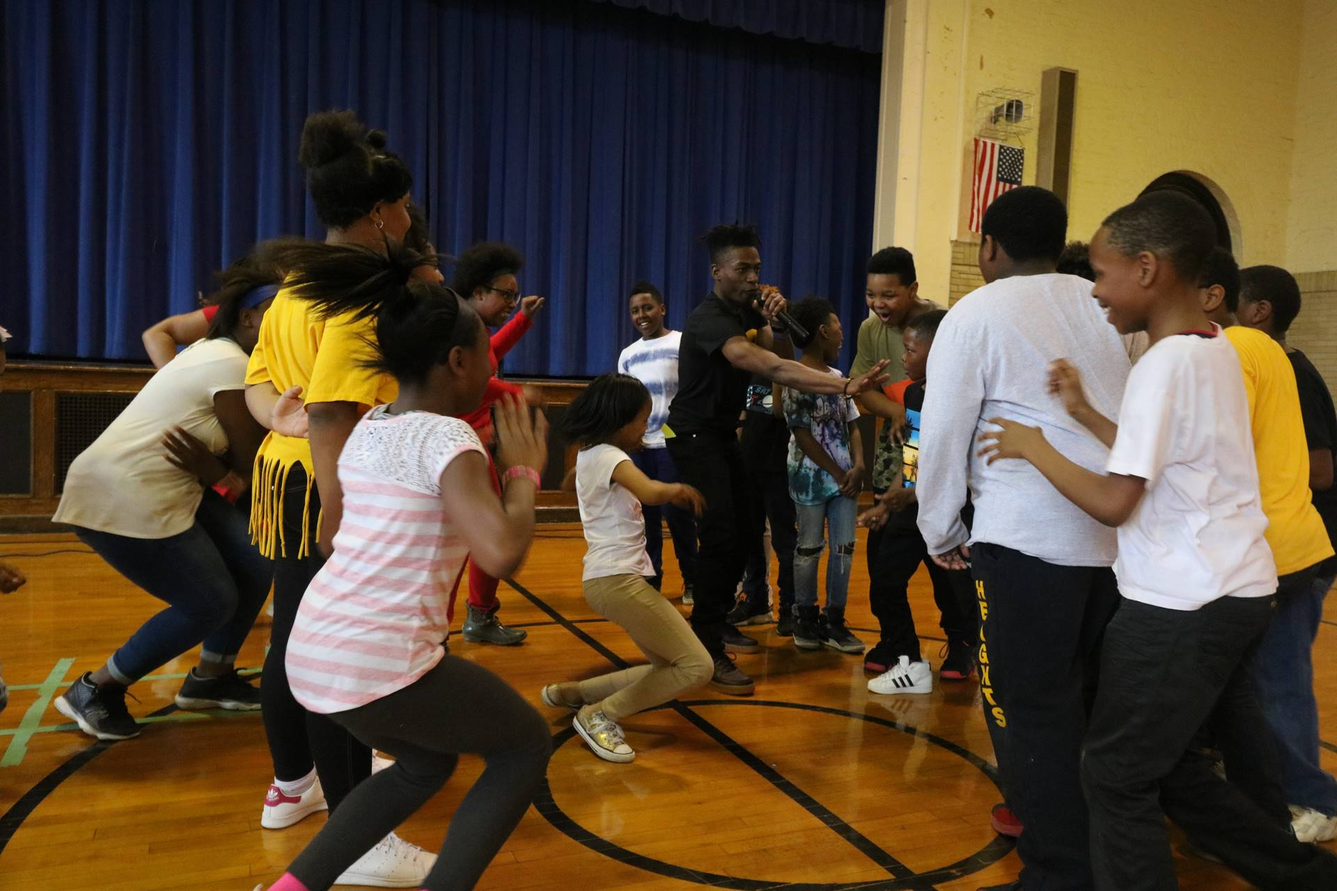 Boys and girls have dance-off with motivational speaker