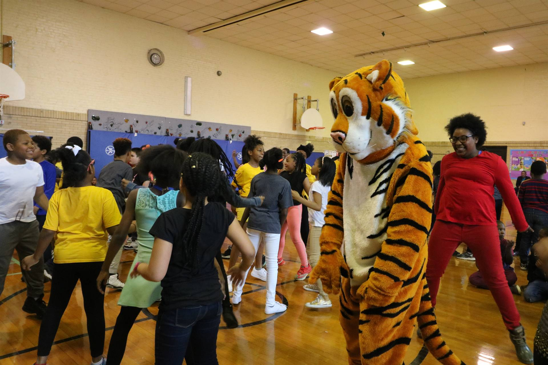 TJ the Tiger dances with students