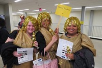 Three females with gold wigs