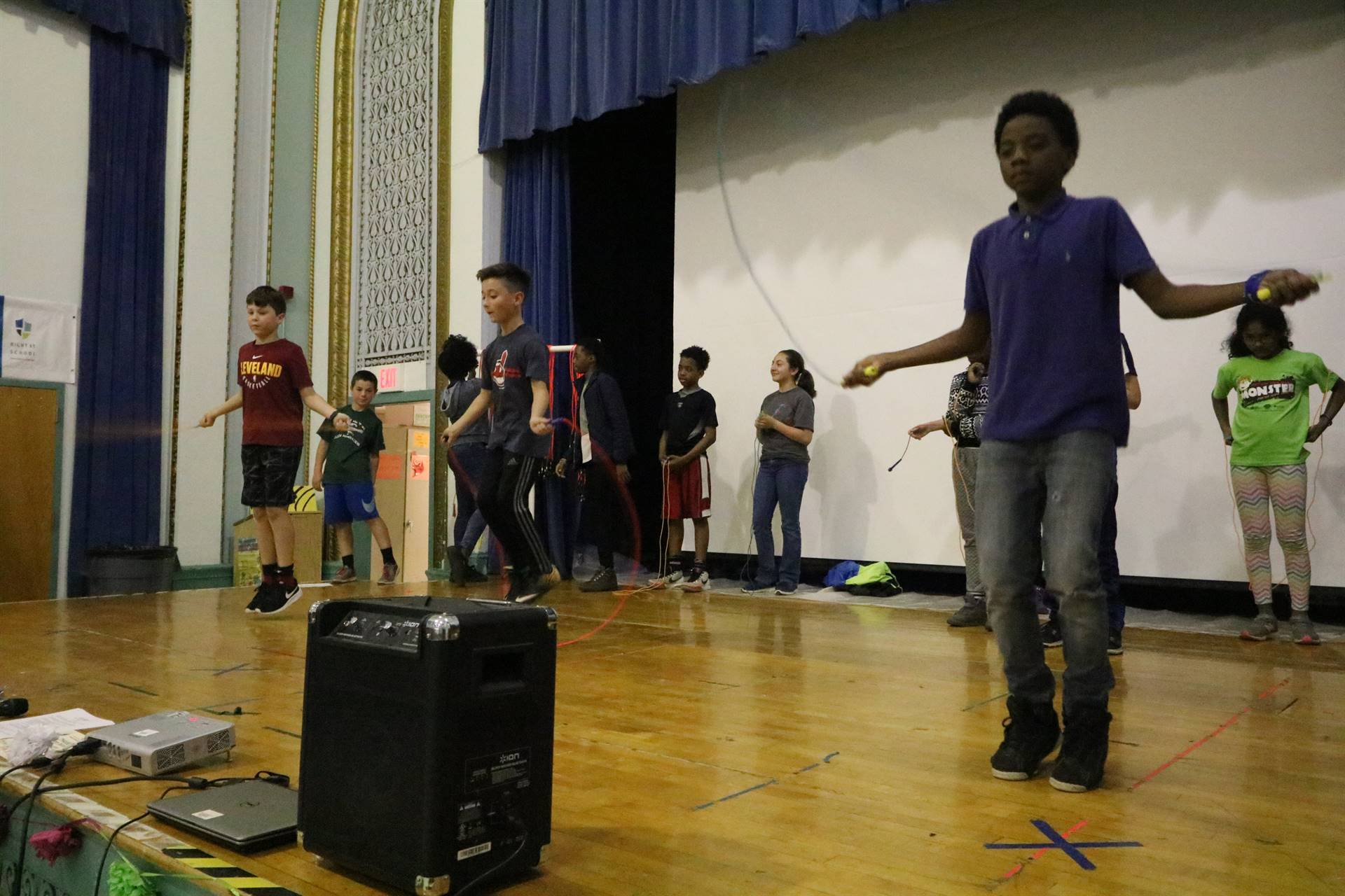 Students on stage jumping rope